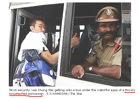 Thickly moustached policeman